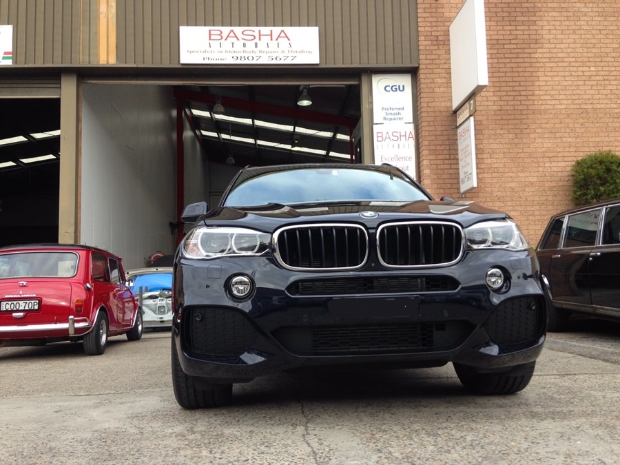 black BMW repaired at Basha